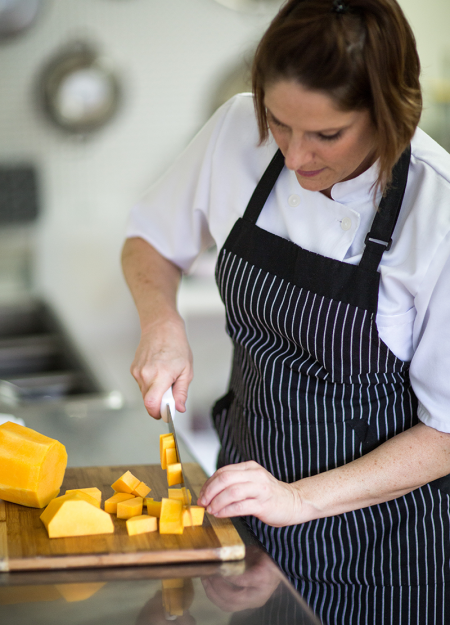 AnneMarie Tanner Chopping Squash in our Maple Street Kitchen